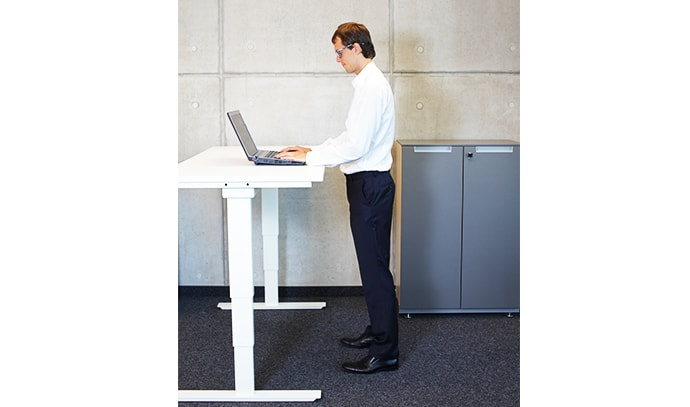 man-working-while-standing