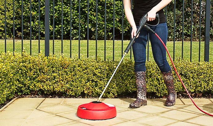 pressure-washer-lady-cleaning-outdoor-tiles