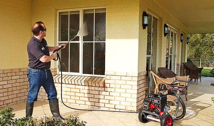 pressure-washer-man-cleaning-windows-outdoor-home