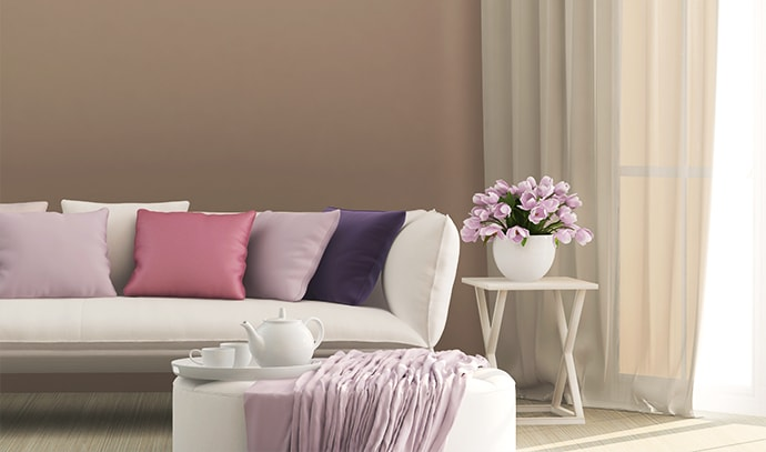 french-modern-living-room-seating-area-pink-lavender-flowers-couch-pillows