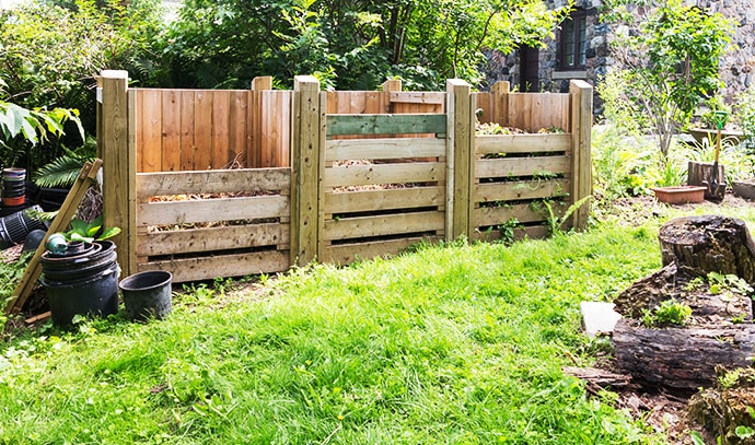 wooden-compost-bins-in-garden-setting