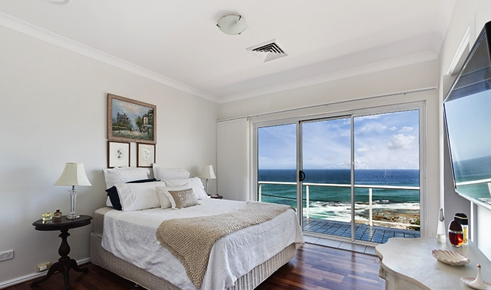modern-bedroom-white-overlooking-beach-view