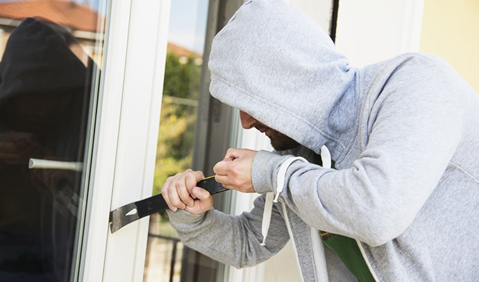 burglar-stealing-house-robbing-home-attempting-theft
