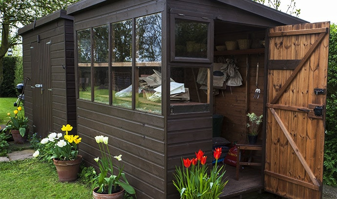 garden-shed-exterior-door-open-tools-flowers-plant-pots
