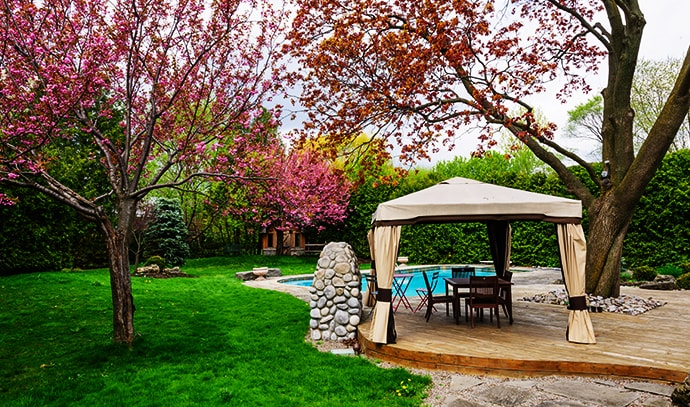 residential-backyard-gazebo-deck-stone-patio-swimming-pool
