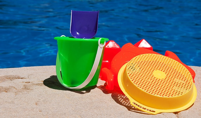 bright-colorful-children-toys-poolside-family-vacation-concept
