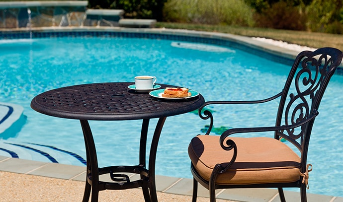 coffee-plate-cast-aluminum-table-single-chair-side-swimming-pool-backyard