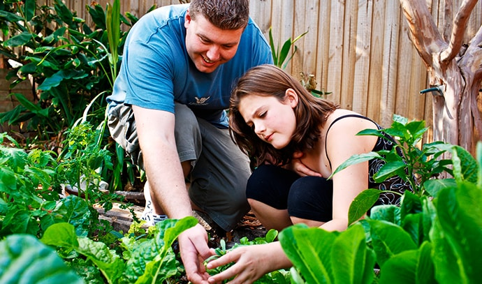 young-girls-adventure-garden-learning-how-grow-food