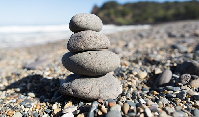 workwell-group-pebble-stones-rock-stack-beach