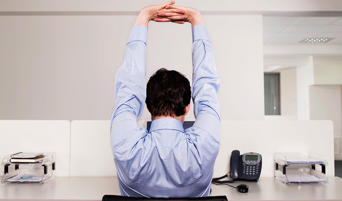 man-stretching-desk-office-businessman