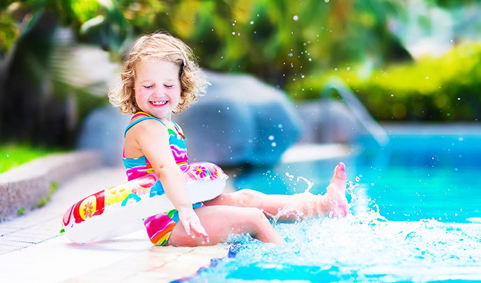 adorable-little-girl-colourful-swimsuit-playing-water-splashes-swimming-pool