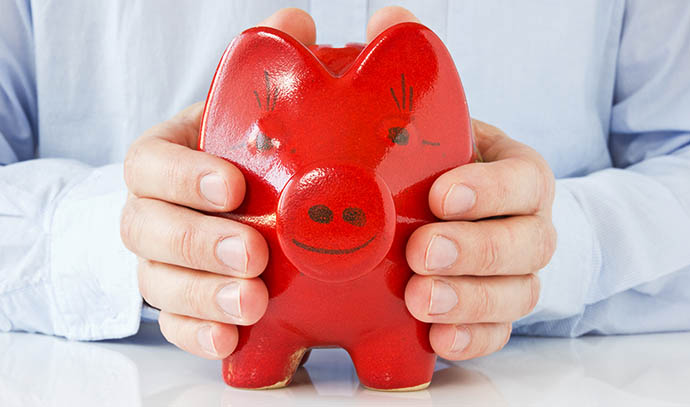 business-man-holding-piggy-bank-coinbank-money-protection