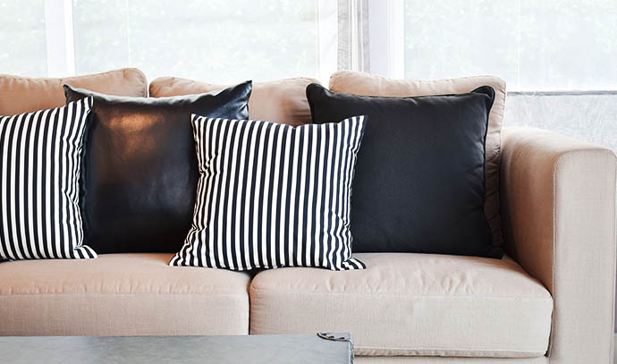 striped-black-leather-pillows-velvet-beige-sofa-modern-industrial-style-living-room
